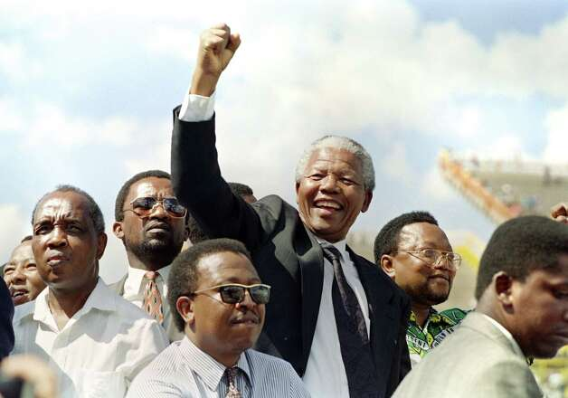 Nelson Mandela greets supporters in 1994 upon his arrival for a rally ahead of his election as president. Photo: WALTER DHLADHLA, Staff / AFP
