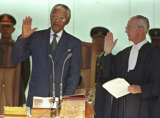 Nelson Mandela, the former prisoner, took  the oath of office in Pretoria, South Africa, in May 1994 to become the country's first black president. Photo: David Brauchli, STR / AP