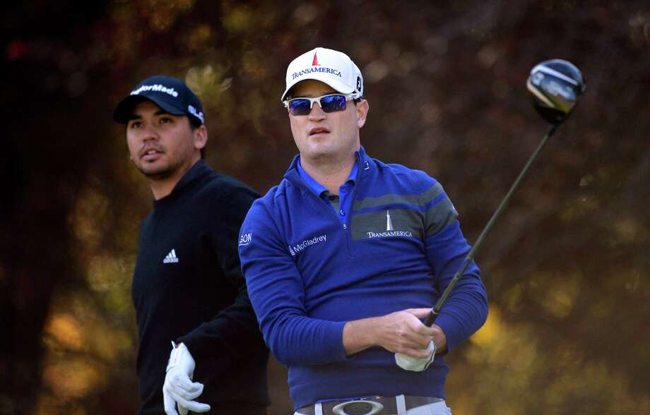 Zach Johnson, right, tees off on the second hole as Jason Day, of Australia, watches during the first round of the Northwestern Mutual World Challenge golf tournament at Sherwood Country Club, Thursday, Dec. 5, 2013, in Thousand Oaks, Calif. (AP Photo/Mark J. Terrill)  ORG XMIT: CAMT111 Photo: Mark J. Terrill / AP