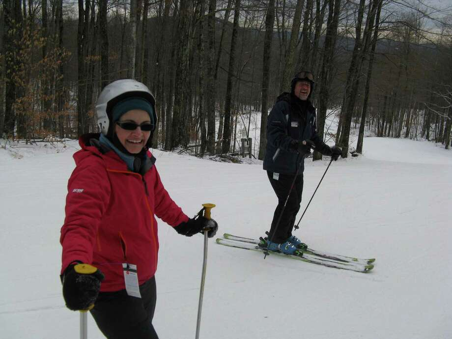 Photo by Herb Terns. Outdoors writer Gillian Scott and Gore Mountain ski instructor Joe Childs.