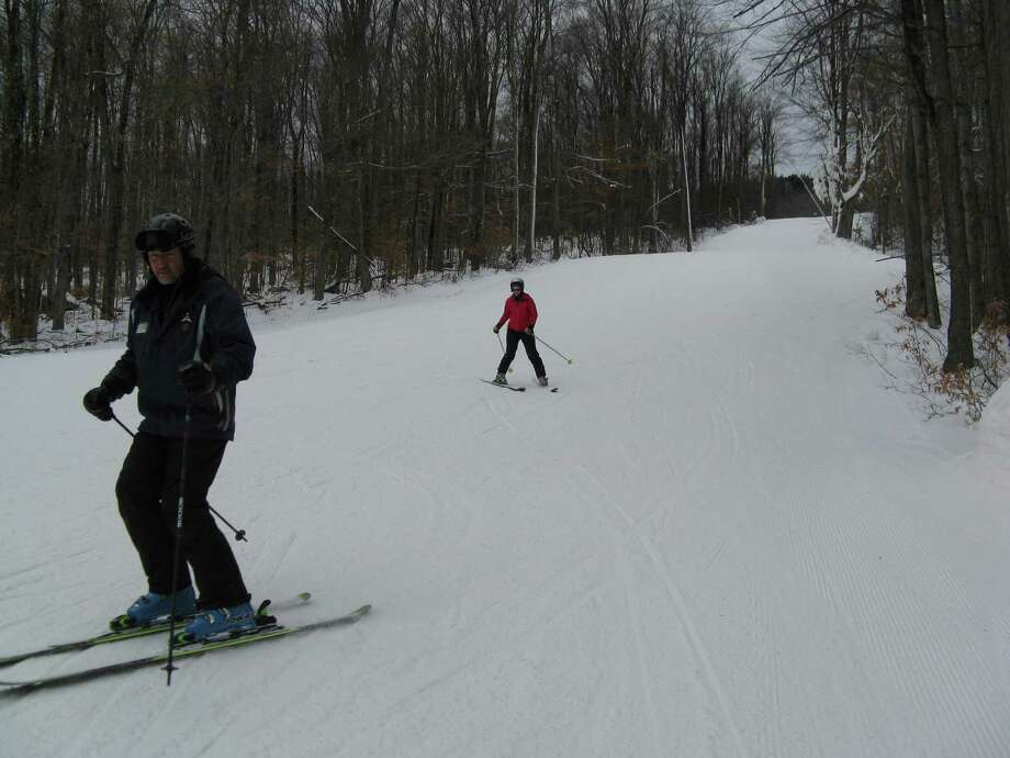 Photo by Herb Terns. Gore Mountain ski instructor Joe Childs and outdoors writer Gillian Scott.