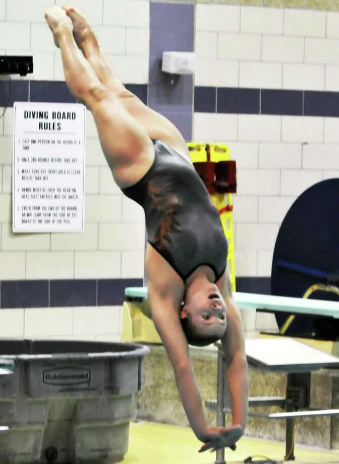 """Ballston Spa High sophomore Addison """"Addy""""  Walkowiak practices for the state diving championships at the school's pool Tuesday Nov. 8, 2011.   (John Carl D'Annibale / Times Union) Photo: John Carl D'Annibale / 00015301A"""