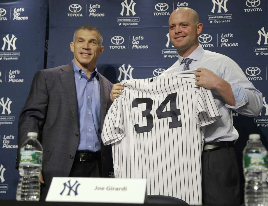 New York Yankees' Brian McCann, right, poses for a picture with his new uniform and manager Joe Girardi at a news conference where he was introduced at Yankee Stadium in New York, Thursday, Dec. 5, 2013.  (AP Photo/Seth Wenig) ORG XMIT: NYSW122 Photo: Seth Wenig / AP