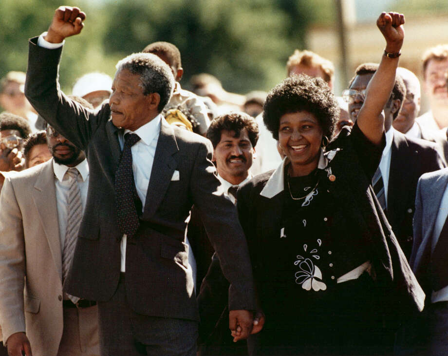 FILE - In this Feb. 11, 1990 file photo, Nelson Mandela, left, and his wife, Winnie, walk out of the Victor Verster prison in Paarl, near Cape Town, South Africa, after Mandela had spent 27 years in jail. South Africa's President Jacob Zuma said, Thursday, Dec. 5, 2013, that Mandela has died. He was 95. (AP Photo/Greg English, File) ORG XMIT: NYNM502 Photo: Greg English / AP