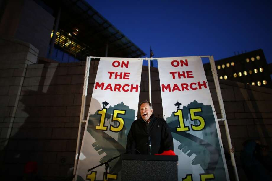 Seattle city council member Mike O'Brien speaks at Seattle City Hall during a rally and march to make $15 the minimum wage in Seattle. The marchers started in SeaTac, the city where a voter initiative to pay workers a minimum of $15 per hour just passed. Photographed on Thursday, December 5, 2013.  (Joshua Trujillo, seattlepi.com) Photo: JOSHUA TRUJILLO, SEATTLEPI.COM