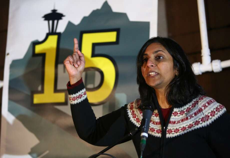 Seattle city council member-elect Kshama Sawant speaks at Seattle City Hall during a rally and march to make $15 the minimum wage in Seattle. The marchers started in SeaTac, the city where a voter initiative to pay workers a minimum of $15 per hour just passed. Photographed on Thursday, December 5, 2013.  (Joshua Trujillo, seattlepi.com) Photo: JOSHUA TRUJILLO, SEATTLEPI.COM