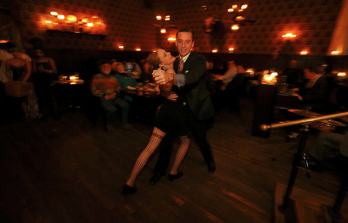 Katy Alexander (left) and Ben Luhrman dance during The Esquire Tavern 80th birthday celebration, that coincides with the date Prohibition ended ?' Dec. 5, 1933 ?' known as national Repeal Day, Thursday Dec. 5, 2013.