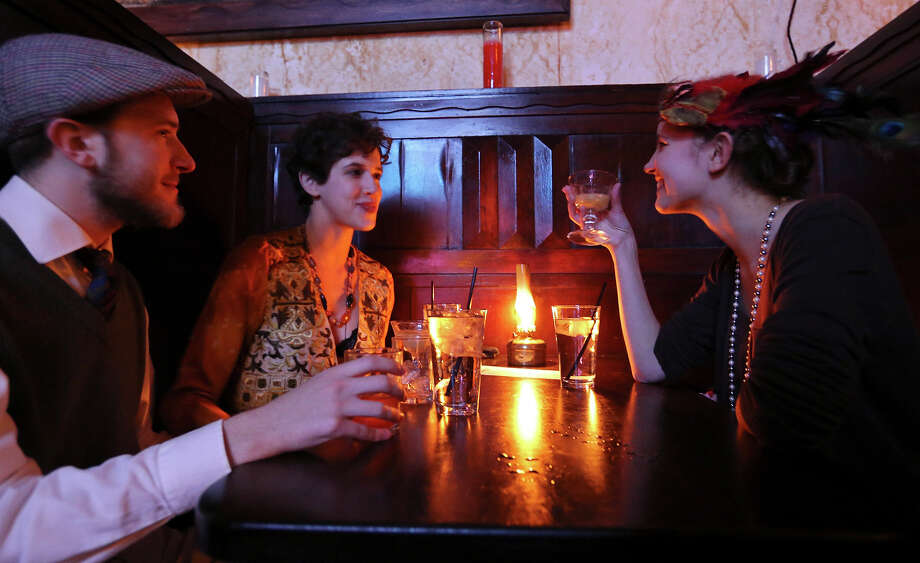 Carl Martin (from left), Tess Outlaw, and Fenna Engelke enjoy drinks during The Esquire Tavern 80th birthday celebration, that coincides with the date Prohibition ended Ñ Dec. 5, 1933 Ñ known as national Repeal Day, Dec. 5, 2013. Photo: Edward A. Ornelas, San Antonio Express-News / © 2013 San Antonio Express-News
