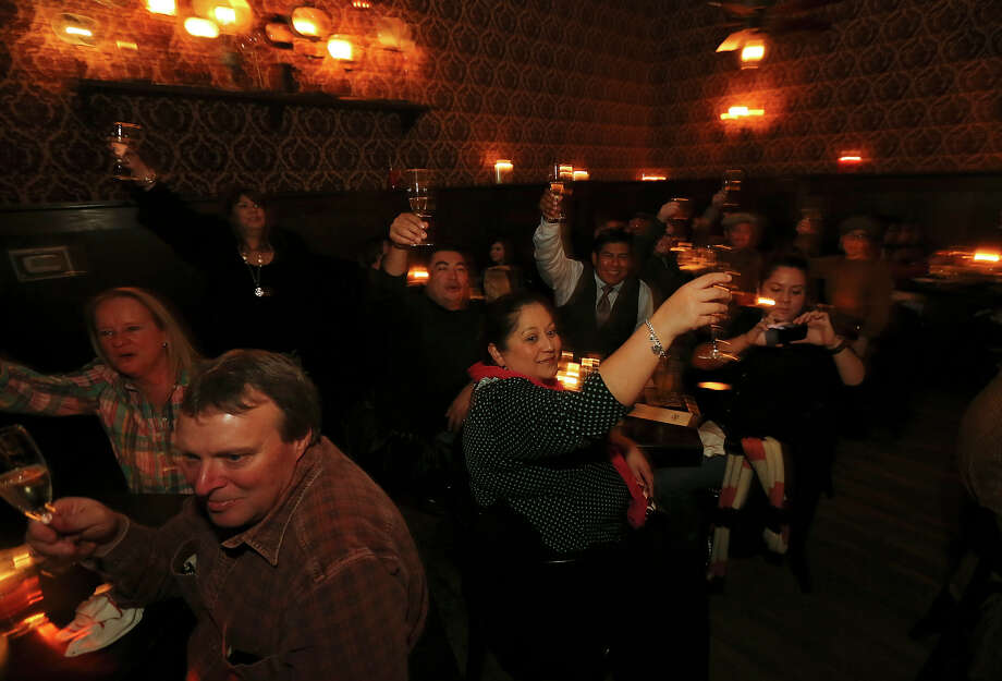 Patrons take part in a champagne toast during The Esquire Tavern 80th birthday celebration, that coincides with the date Prohibition ended Ñ Dec. 5, 1933 Ñ known as national Repeal Day, Dec. 5, 2013. Photo: Edward A. Ornelas, San Antonio Express-News / © 2013 San Antonio Express-News