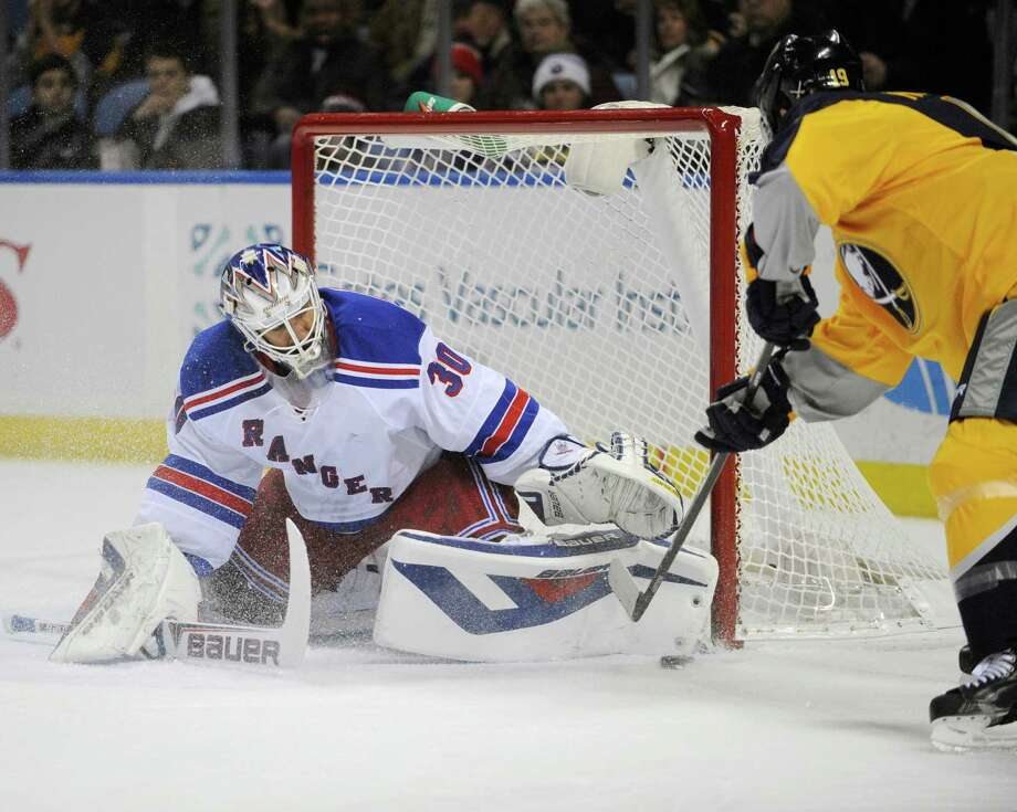 New York Rangers goaltender Henrik Lundqvist (30), of Sweden, stops Buffalo Sabres center Cody Hodgson, right, during the first period of an NHL hockey game in Buffalo, N.Y., Thursday, Dec. 5, 2013. (AP Photo/Gary Wiepert) ORG XMIT: NYGW101 Photo: Gary Wiepert / FR170498 AP