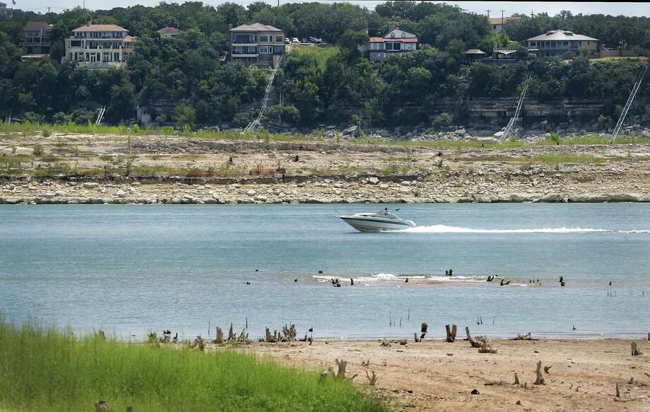 Boaters on Austin's Lake Travis remain careful to avoid stumps or sand bars exposed by low water levels. Photo: San Antonio Express-News