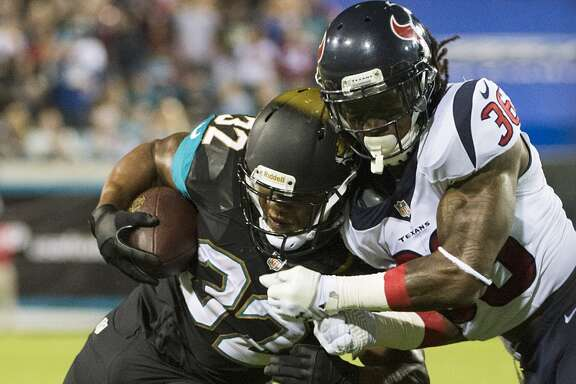 Texans strong safety D.J. Swearinger (36) brings down Jaguars running back Maurice Jones-Drew.