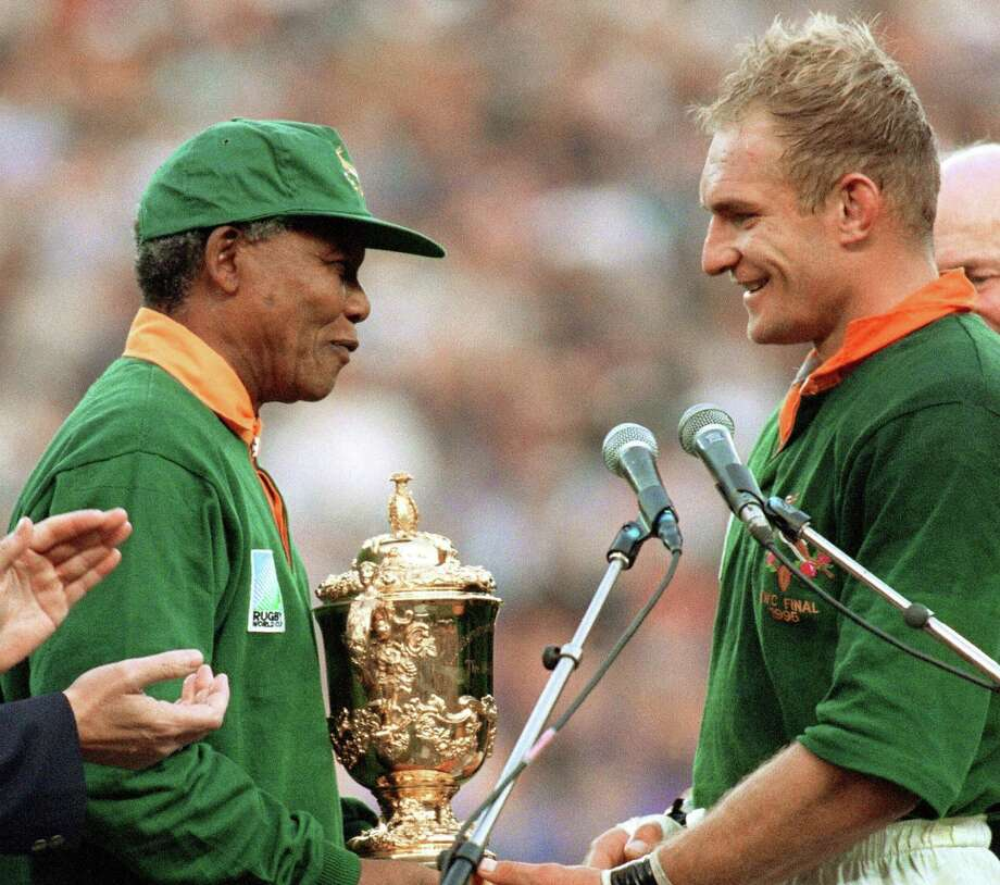 Nelson Mandela (left) chats with South Africa rugby captain Francois Pienaar after the 1995 World Cup. Photo: Getty Images File Photo