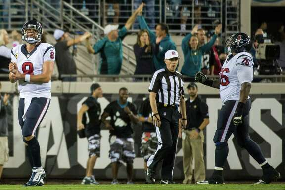 Matt Schaub (8), who replaced starting quarterback Case Keenum in the second half, dejectedly leaves the field after throwing a fourth-quarter interception that essentially sealed the Texans' fate.