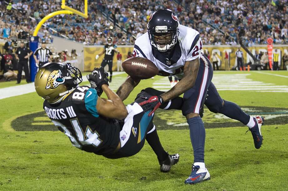 Texans cornerback Johnathan Joseph (24) breaks up a pass intended for Jaguars wide receiver Cecil Shorts (84). Photo: Smiley N. Pool, Houston Chronicle