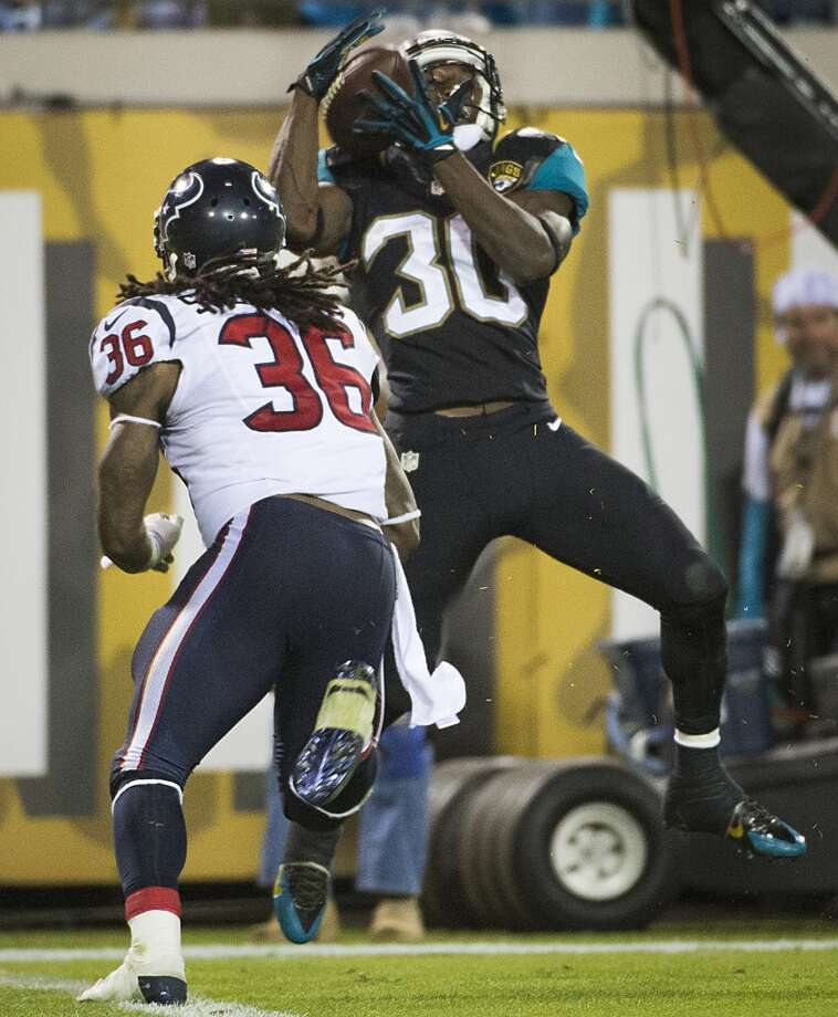 Jaguars running back Jordan Todman (30) catches a touchdown pass from wide receiver Ace Sanders as Texans strong safety D.J. Swearinger (36) defends. Photo: Smiley N. Pool, Houston Chronicle