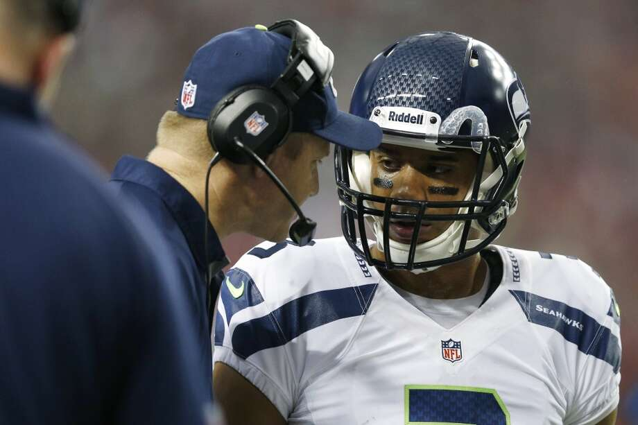 """DARRELL BEVELLSeahawks offensive coordinatorQ: What has stood out to you about Russell Wilson's performance this season?DB: """"I think the thing that stands out the most is his consistency. I mean, I've heard him talk about it, but how consistent he is for us -- helping us to get into the right situations, the decisions that he makes, the plays that he makes. Sometimes it's right there on time, sometimes he's got to buy a little bit of time. And just the consistency of his play, of what we can expect from him, the mental part of the game, just everything and how consistent he is at it."""" Photo: Joe Robbins, Getty Images"""