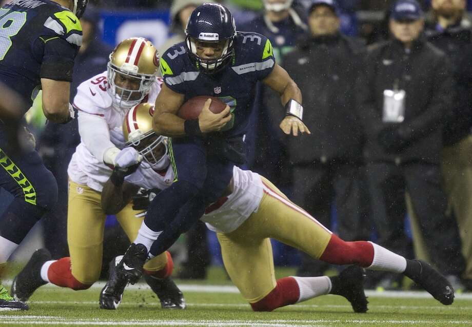 """PATRICK WILLIS49ers linebackerQ: What do you think of Russell Wilson?PW: """"I think that Russell Wilson is a good quarterback. He's definitely establishing his self as one of the better quarterbacks in this league, and it's great competition to play against him two times a year. And certainly this Sunday, we've got to make sure that we try to keep him contained and just get after him."""" Photo: Stephen Brashear, Getty Images"""