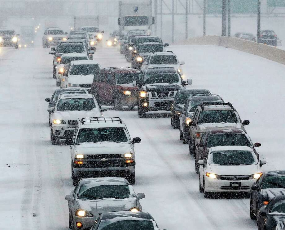 Traffic on the Broadway Extension in north Oklahoma City  is slowed due to snow and sleet brought  by a winter weather system  that moved across the state Thursday, Dec. 5, 2013. Photo: Jim Beckel, AP / THE OKLAHOMAN