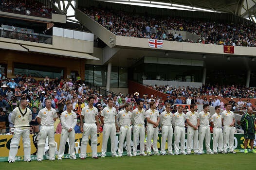 Australian cricketers observe a minutes silence to mark the passsing of former South African president Nelson Mandela on the second day of the second Ashes cricket Test match between England and Australia in Adelaide on December 6, 2013. Nelson Mandela, the revered icon of South Africa's anti-apartheid struggle and a towering figure of 20th century politics, died on December 5 aged 95. Photo: SAEED KHAN, AFP/Getty Images / 2013 AFP