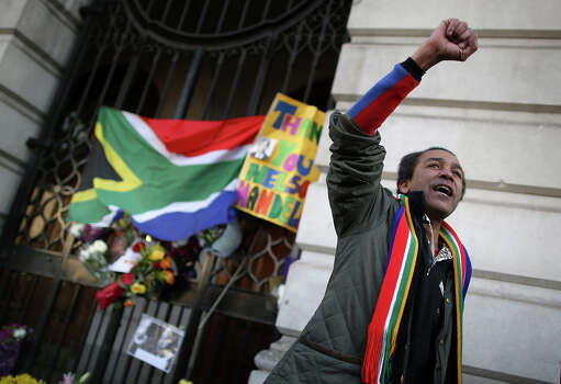 A man gestures as he reacts to the death of Nelson Mandela at the South African embassy near Trafalgar Square on December 6, 2013 in London, England. Mandela was a leader that helped conquer apartheid in racially divided South Africa after being jailed for his activism for decades. He was South Africa's first black president. He died yesterday at the age of 95. Photo: Peter Macdiarmid, Getty Images / 2013 Getty Images