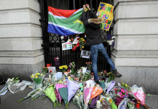 Members of the public lay tributes to former South African President Nelson Mandela outside South Africa House near Trafalgar Square on December 6, 2013 in London, England. Mandela was a leader that helped conquer apartheid in racially divided South Africa after being jailed for his activism for decades. He was South Africa's first black president. He died yesterday at the age of 95. Photo: Stuart C. Wilson, Getty Images / 2013 Getty Images