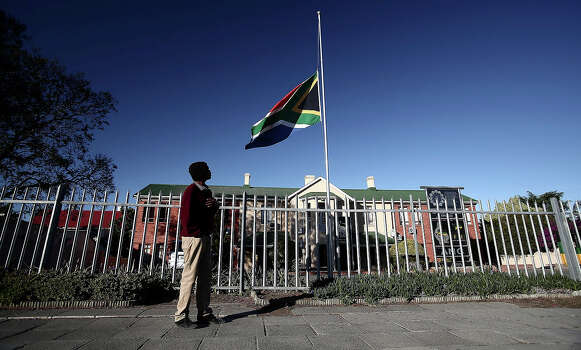 The South African flag flies half mast on December 6, 2013, in East London, South Africa. The Father of the Nation, Nelson Mandela, Tata Madiba, passed away quietly on the evening of December 5, 2013 at his home in Houghton with family. Photo: Gallo Images, Getty Images / 2013 Gallo Images (PTY) LTD