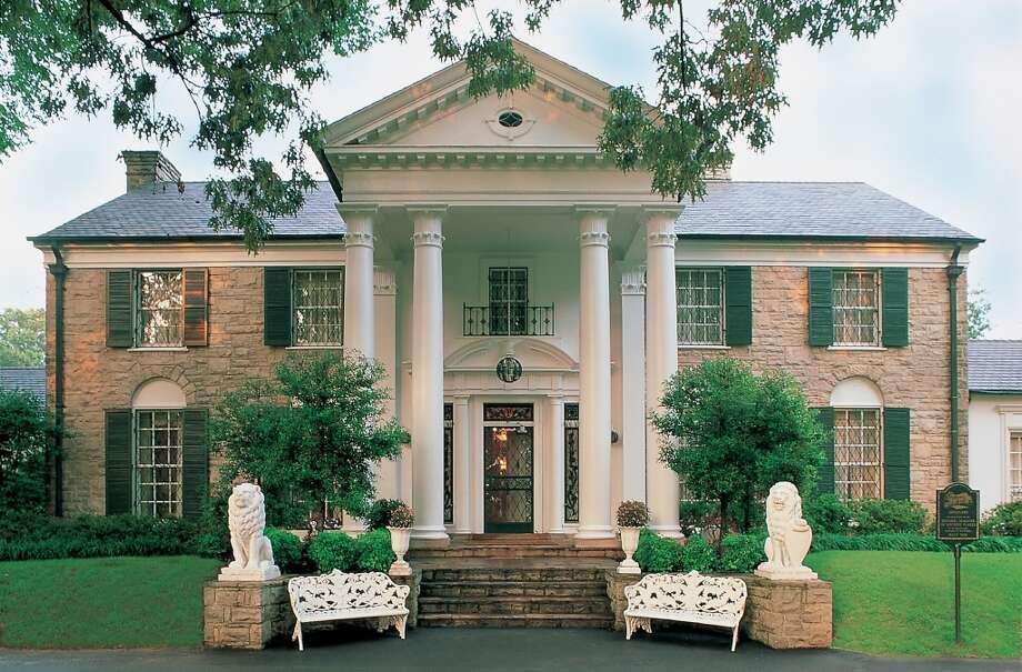 Elvis Presley buys a mansion at 3734 Bellevue Blvd. for $100,000 in Memphis, Tenn., and names it Graceland. Photo: Elvis Presley Enterprises Inc. MCT