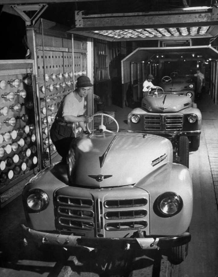 Toyota begins exporting cars to the U.S., among them the Land Cruiser Photo: Margaret Bourke, Getty Images