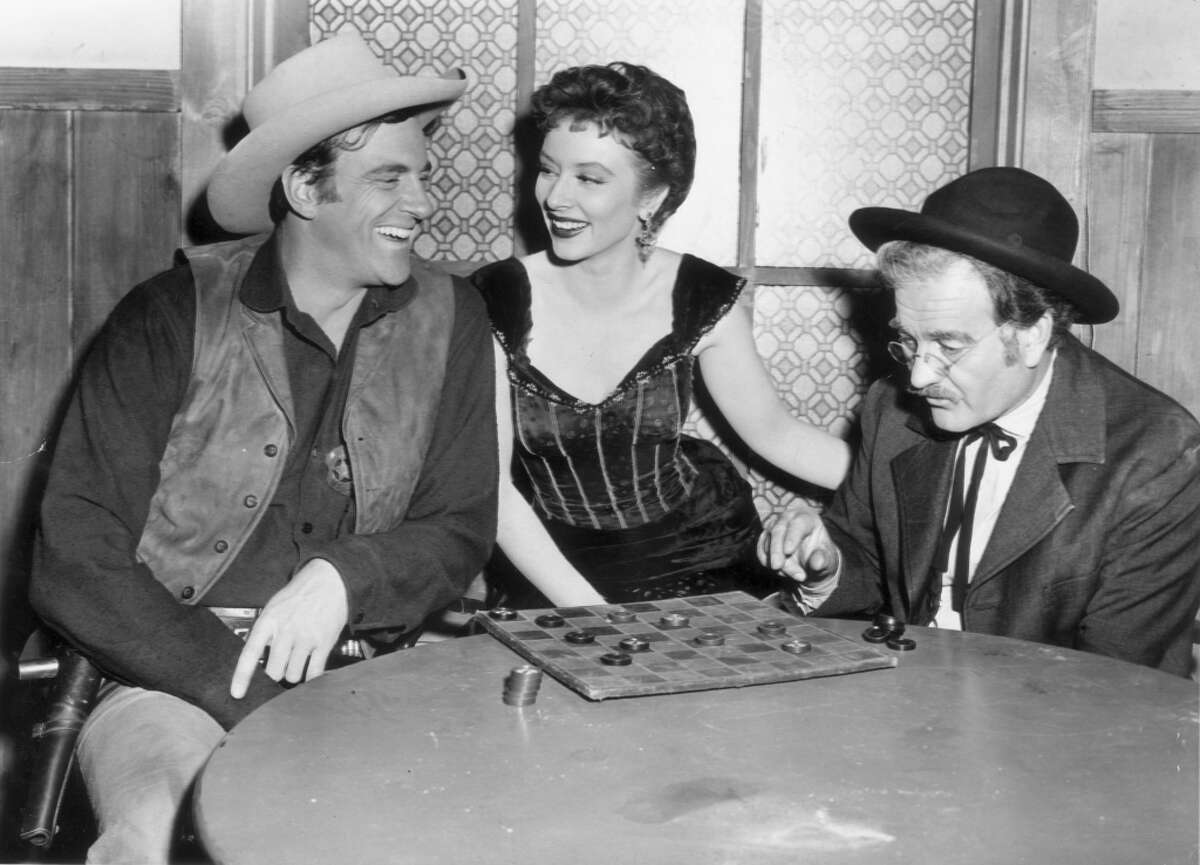 """Gunsmoke James Arness starred in """"Gunsmoke,"""" which began its run in 1955, the year that TV began producing Westerns meant for adults, not children."""