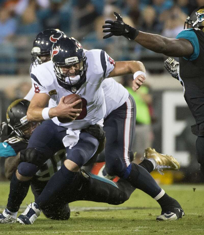 Texans quarterback Matt Schaub (8) is sacked by Jaguars defensive end Andre Branch (90). Photo: Smiley N. Pool, Houston Chronicle