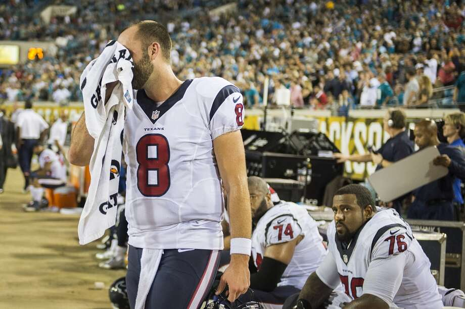 Texans quarterback Matt Schaub reacts on the sidelines after throwing an interception late in the game. Photo: Smiley N. Pool, Houston Chronicle