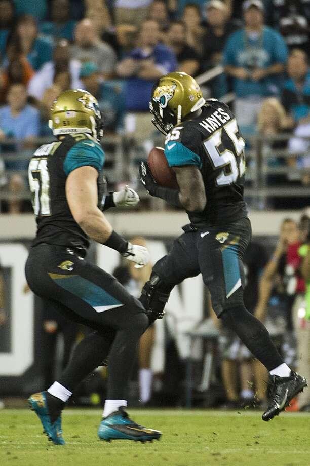 Jaguars outside linebacker Geno Hayes (55) intercepts a pass by Texans quarterback Matt Schaub (8). Photo: Smiley N. Pool, Houston Chronicle