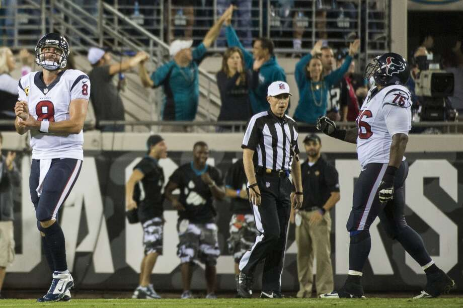 Texans quarterback Matt Schaub (8) walks off the field after throwing an interception. Photo: Smiley N. Pool, Houston Chronicle