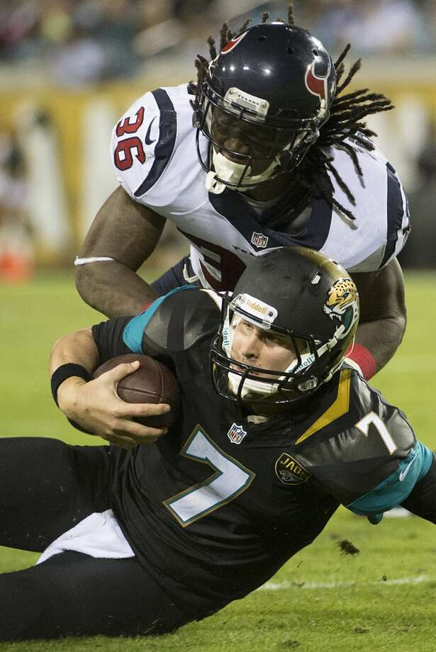 Jaguars quarterback Chad Henne (7) slides for a first down as Texans strong safety D.J. Swearinger (36) defends. Photo: Smiley N. Pool, Houston Chronicle
