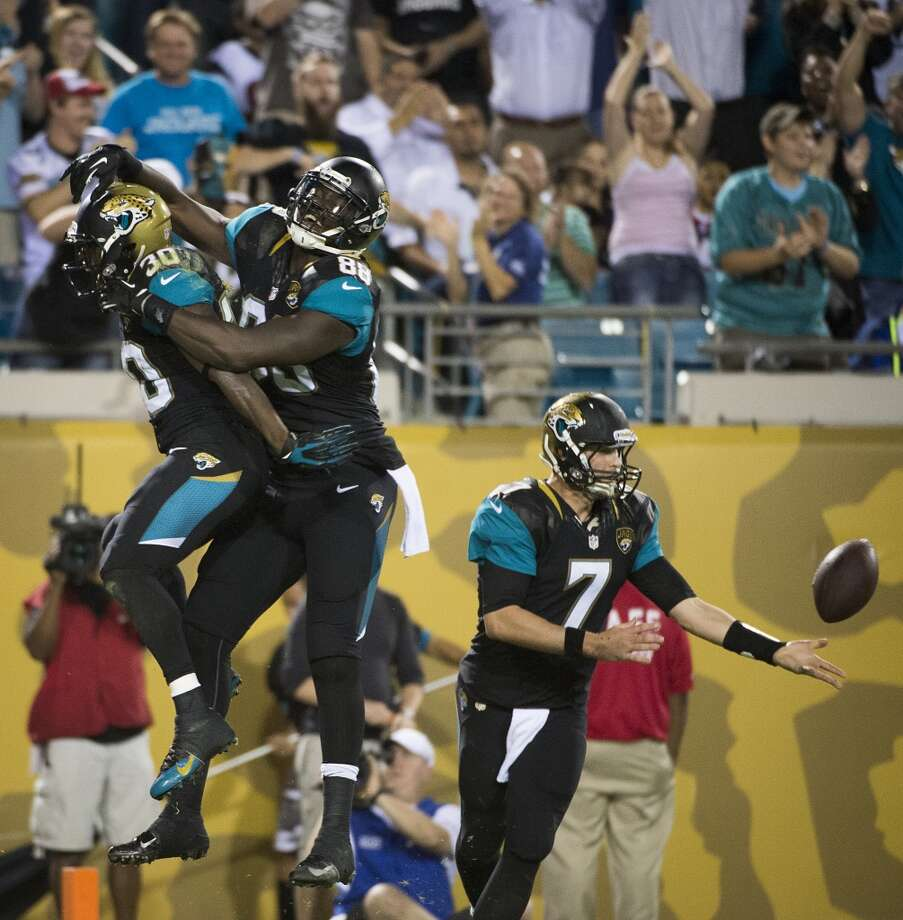 Jaguars running back Jordan Todman (30) celebrates with tight end Danny Noble (88) after catching a touchdown pass from wide receiver Ace Sanders. Photo: Smiley N. Pool, Houston Chronicle
