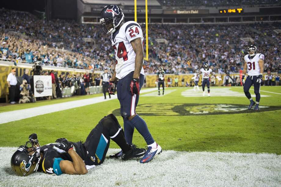 Texans cornerback Johnathan Joseph (24) stands over Jaguars wide receiver Cecil Shorts (84) after breaking up a pass. Photo: Smiley N. Pool, Houston Chronicle