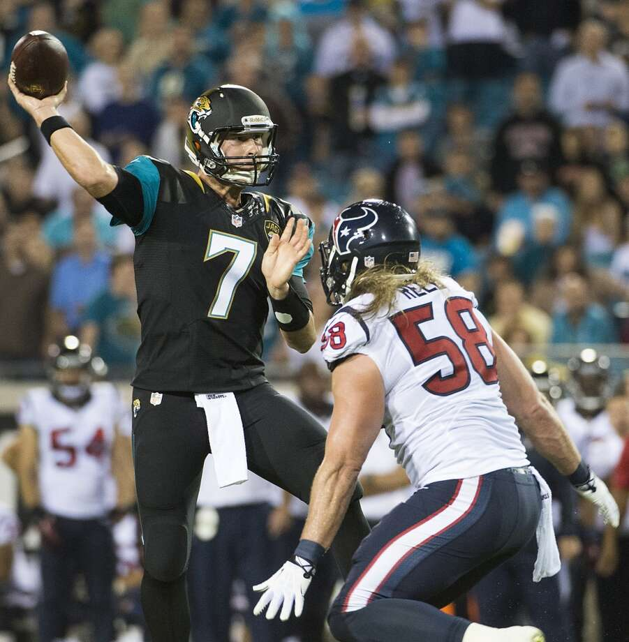 Jaguars quarterback Chad Henne (7) gets off a pass over Texans outside linebacker Brooks Reed. Photo: Smiley N. Pool, Houston Chronicle