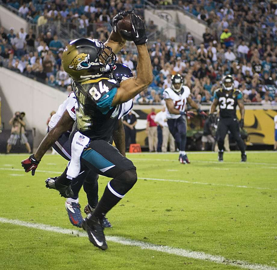 Jaguars wide receiver Cecil Shorts (84) catches a 6-yard touchdown pass as Texans cornerback Johnathan Joseph (24) defends. Photo: Smiley N. Pool, Houston Chronicle