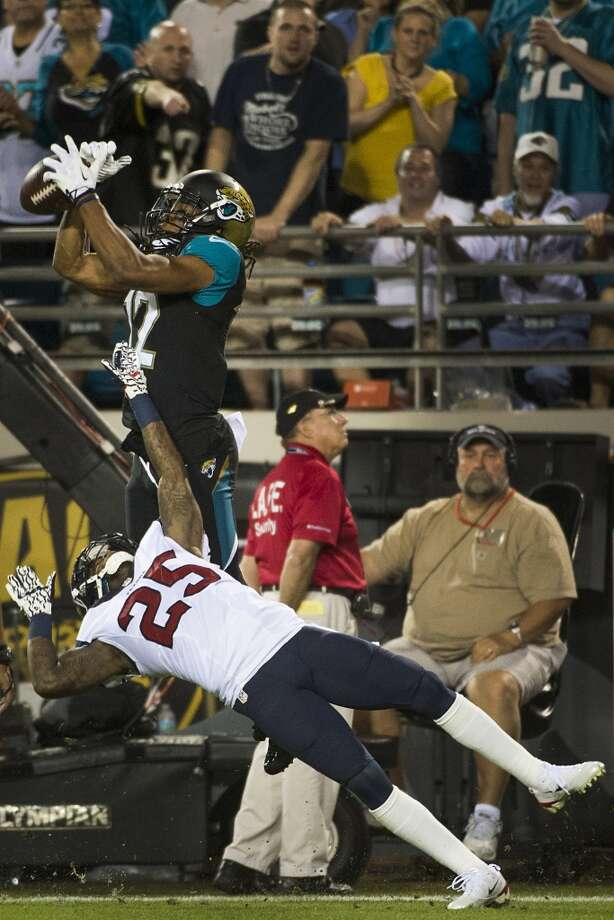 Jaguars wide receiver Mike Brown (12) can't make a catch in the end zone as Texans cornerback Kareem Jackson (25) defends. Photo: Smiley N. Pool, Houston Chronicle