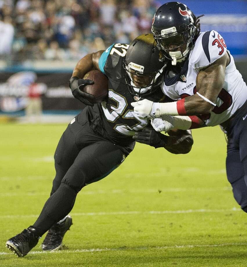 Texans strong safety D.J. Swearinger (36) brings down Jaguars running back Maurice Jones-Drew. Photo: Smiley N. Pool, Houston Chronicle