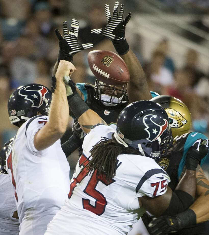 Jaguars defensive end Ryan Davis (59) knocks down a pass by Texans quarterback Case Keenum. Photo: Smiley N. Pool, Houston Chronicle