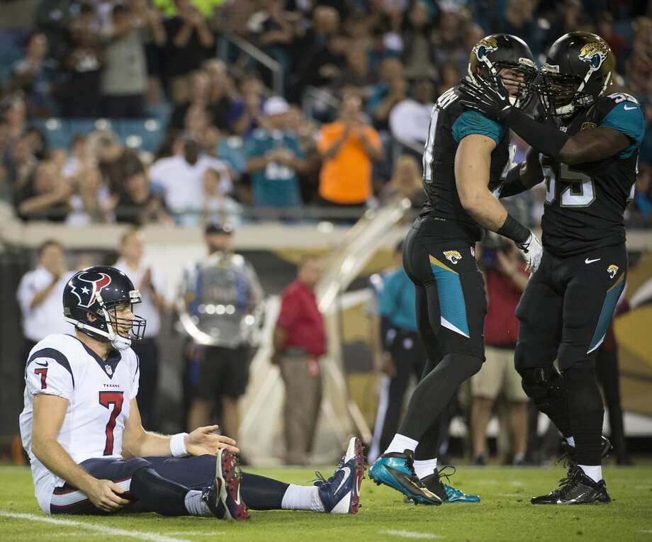 Jaguars linebackers Paul Posluszny (51) and Geno Hayes (55) celebrate after a hit on Texans quarterback Case Keenum. Photo: Smiley N. Pool, Houston Chronicle