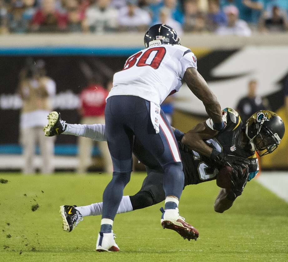 Jaguars cornerback Alan Ball (23) intercepts a pass intended for Texans wide receiver Andre Johnson. Photo: Smiley N. Pool, Houston Chronicle