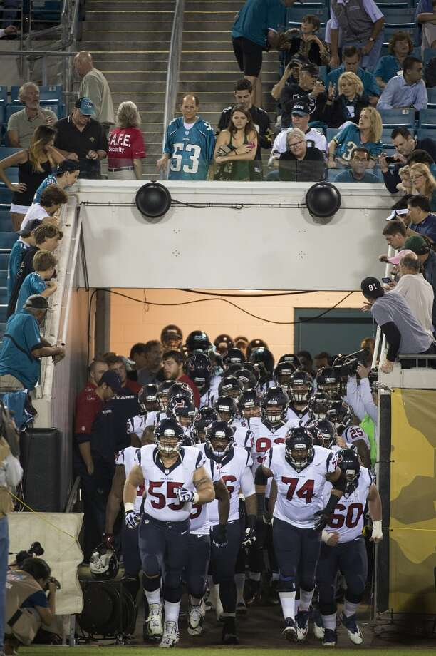 Texans center Chris Myers (55) and guard Wade Smith (74) lead the team onto the field. Photo: Smiley N. Pool, Houston Chronicle
