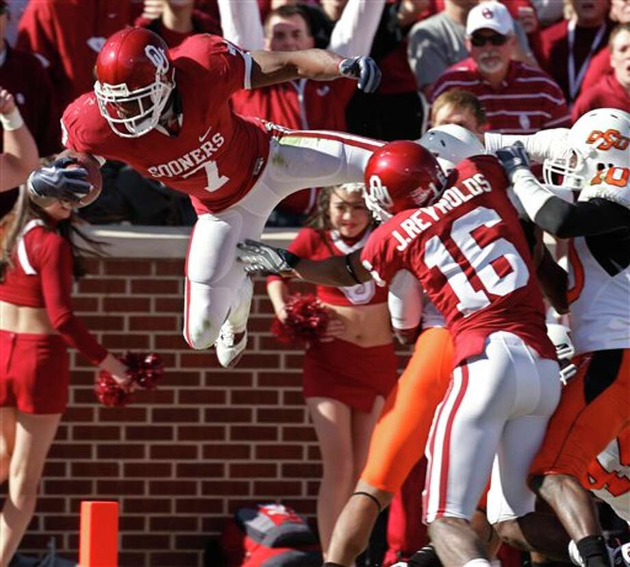 OU in that rare role of spoiler in the Bedlam showdown with OSU. Photo: Sue Ogrocki, AP / AP