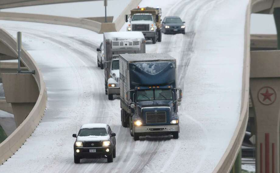 Traffic slowly moves along an ice covered highway Friday, Dec. 6, 2013, in Dallas.  Winter storm and ice warnings are in effect through much of today for parts of six states in the Midwest, including Texas, Missouri, Illinois and Indiana. Photo: LM Otero, AP / AP