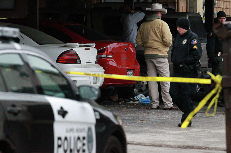 Law enforcement officers investigate a crime scene where a 23-year-old man that was shot to death after 2:00 a.m. by a University of the Incarnate Word police officer after a traffic stop that ended in the parking lot of the Treehouse Apartments at Broadway and Arcadia Place in Alamo Heights. Lt. Cindy Pruitt of the Alamo Heights Police Department said the man struggled with the officer after the stop and was shot. An investigation of the incident is ongoing. Photo: JOHN DAVENPORT, SAN ANTONIO EXPRESS-NEWS / ©San Antonio Express-News/Photo may be sold to the public