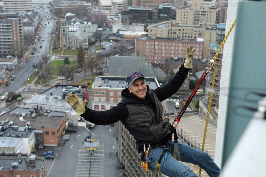 Brian VanOrsdel rappels from the one of Stamford, Conn's tallest buildings, The Landmark Building with the help of  on Friday December 6, 2013. Photo: Dru Nadler / Stamford Advocate Freelance