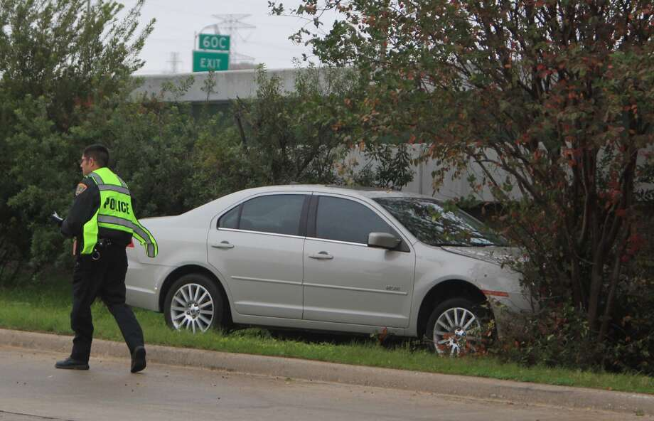 HPD works the scene of an accident along the inbound frontage road of the North Freeway where a man swerved for about two blocks on the surface street and jumped the curb to finally stop by crashing into a tree.  ( Mayra Beltran / Houston Chronicle )